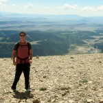Zach on Mount Bross, Pikes Peak, Alma, and Fairplay in background